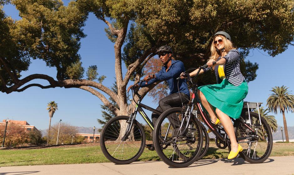 Electric Bike IZIP Vibe HS LS Couple Riding Park
